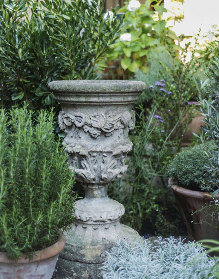The carved stone pedestal?  Uniacke has a passion for rare antiques, and is known for her uncanny ability to discover them. During the course of the renovation, whenever she found a piece she especially liked she'd put it aside for her garden.