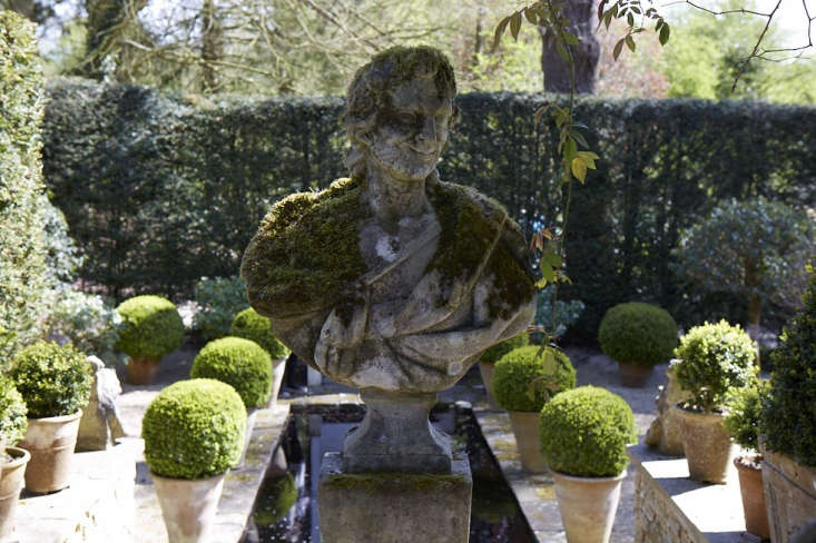 A cheeky satyr with a rich cloak of green moss guards the entrance to the enclosed Italian garden.