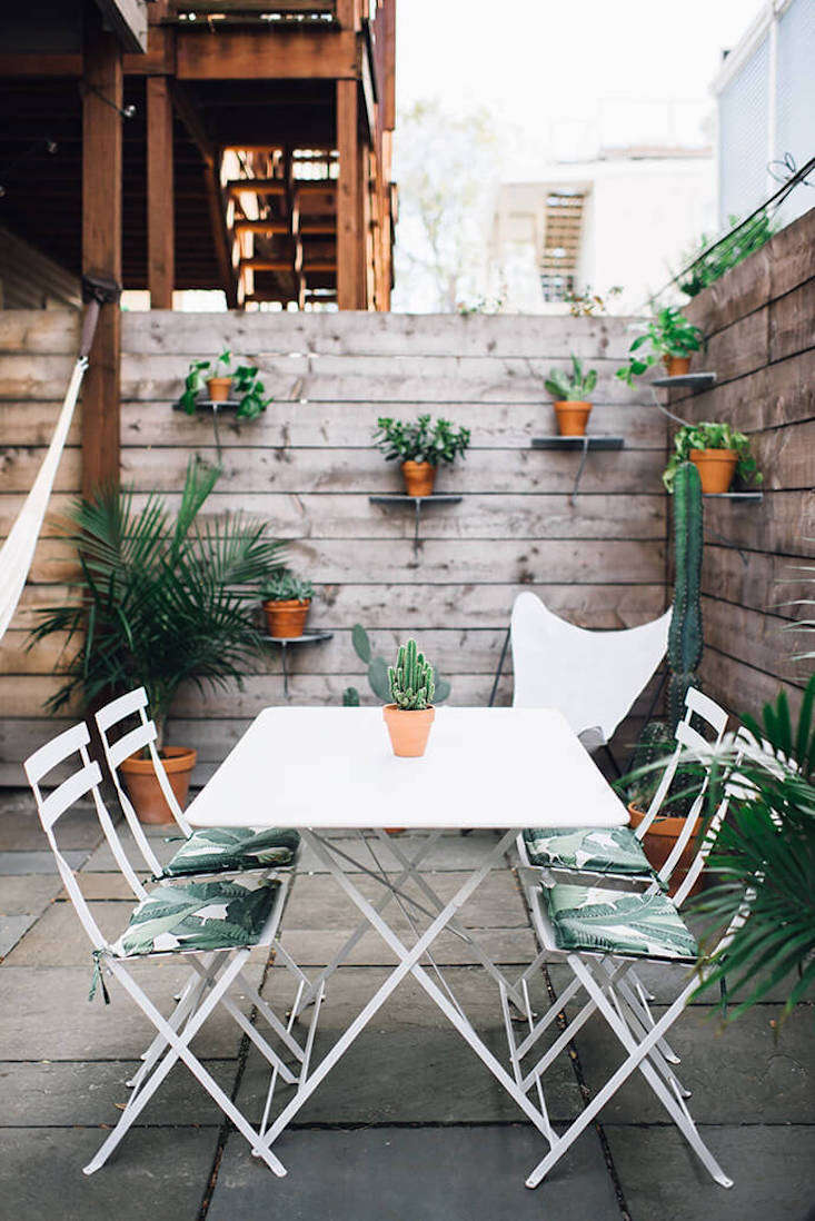 Boston-based photographer Cambria Grace and stylist Lauren Wells, partners at Wells and Grace, also teamed up recently to offer an intimate glimpse of Wells' small-space city garden. Photograph by Cambria Grace.