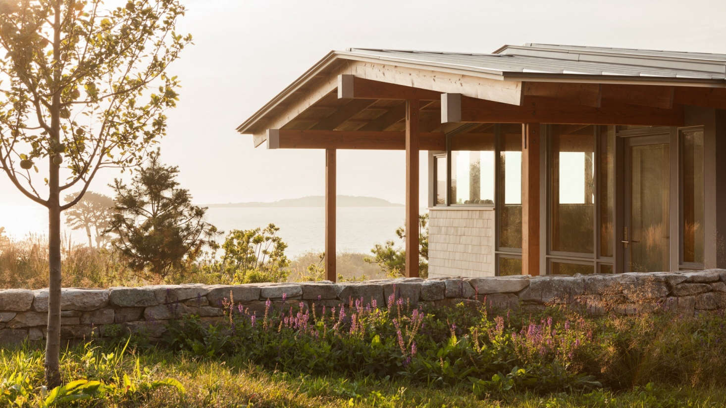 The house at twilight. The stone walls, open meadows, and apple trees recallthe property&#8