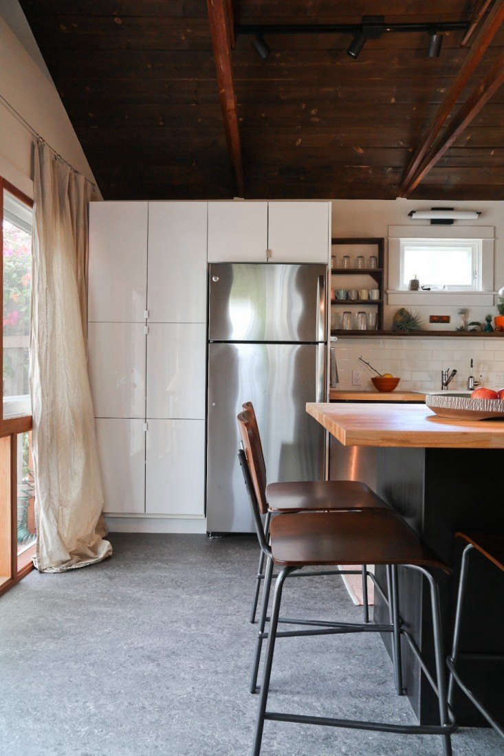 A Hollywood couple remodeled their 0-year-old garage to become a miniature house in full, complete with a living space, kitchen, bedroom, bath, and private patio. Read the whole story in Rehab Diary: From Garage to Tiny Cottage in LA, on a Budget. Photograph by Bethany Nauert.