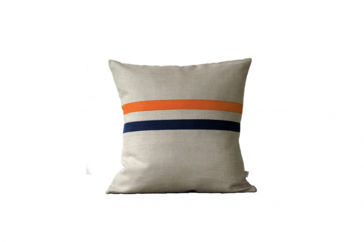 A \16-inch-square Back to School Colorblock Stripe Pillow Cover is available in several color combinations including orange and navy as shown and is \$75 from Jillian Rene Decor via Etsy.