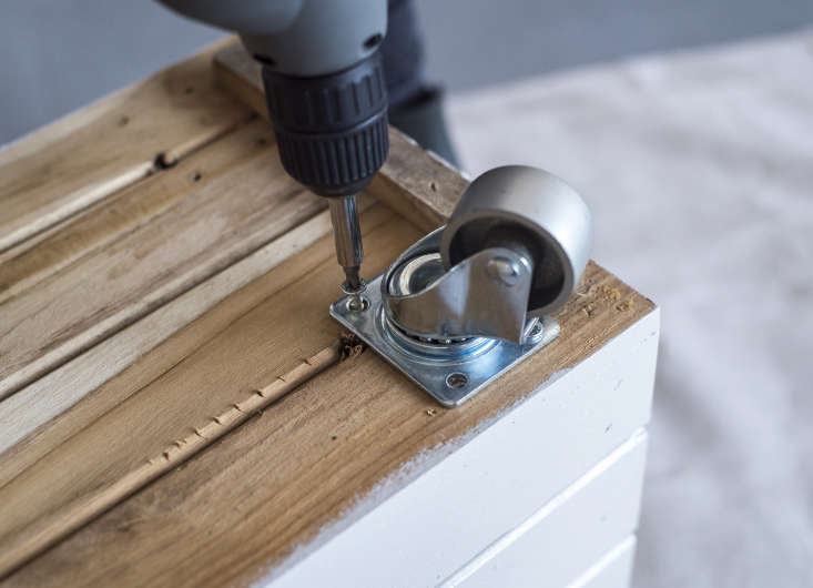 We used a drill bit the same size as the screws and attached the casters using wood screws.