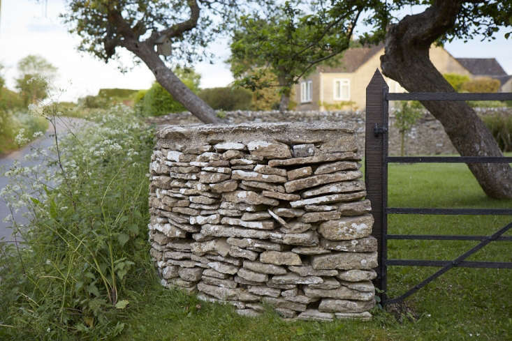 Interesting textures and harmonious tones make a dry stone wall a sympathetic boundary treatment in gardens.