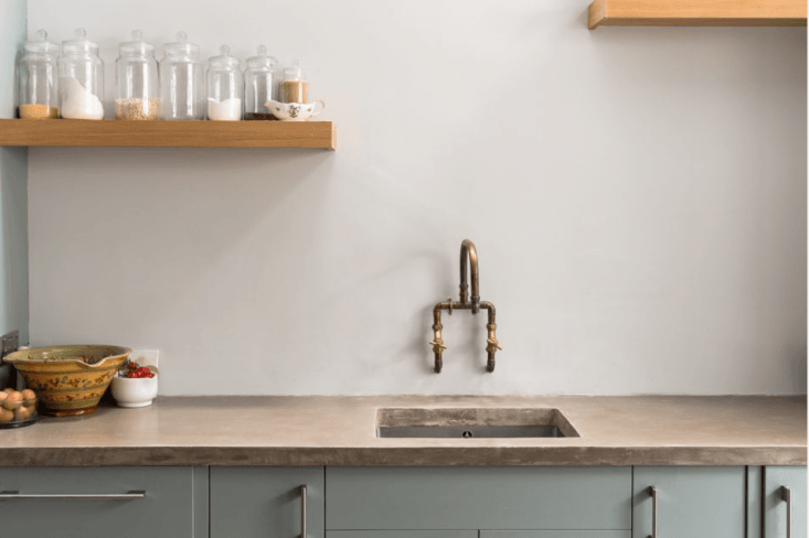 Copper and brass plumbing parts are the components of an artful faucet in this week&#8\2\17;s Steal This Look post. Photograph courtesy of The Modern House.