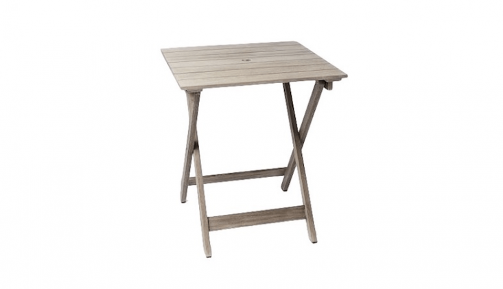 A Portside Folding Bistro Table has a wire-brushed solid wood frame; \$\160 (marked down from \$\2\29) at West Elm.