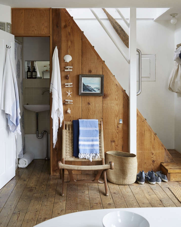 Designer Glenn Ban leaves shoes right by the door in his summer rental. See A Beach Cottage in Provincetown, Styled for Budget-Minded Summer Living. Photograph by Stephen Johnson.