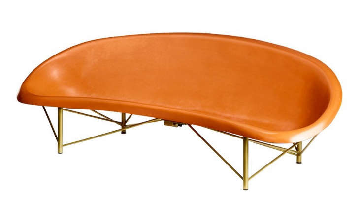 Shown in orange, a Helios Lounge from Galanter & Jones also has a built-in heating system and is made of cast stone, available in white and three other colors. The frame comes in four finishes, including brass as shown and silver, as shown in the courtyard garden; \$7,900.