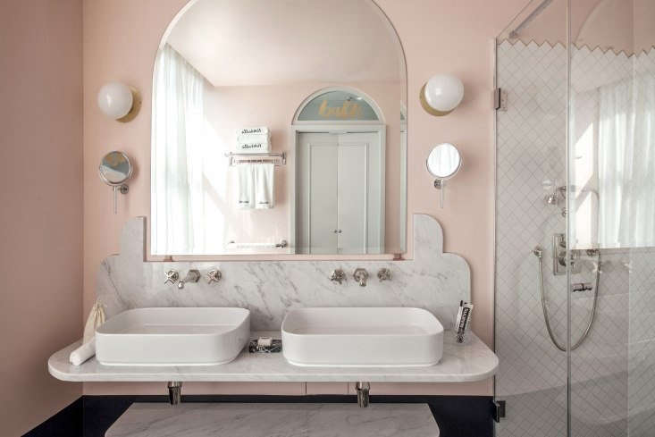 In this week&#8\2\17;s Hotels & Lodging post, Margot checks into a London hotel with scalloped Carrara marble in the bath. Photograph by Karel Balas, courtesy of Henrietta Hotel.