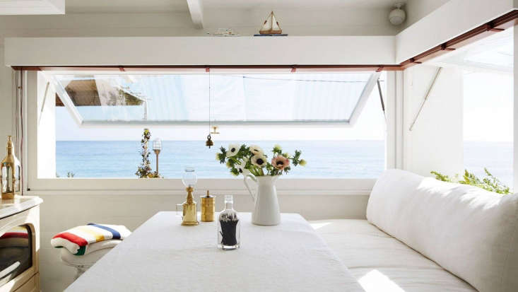 A Riviera seaside cabin that feels like a houseboat. See how to replicate the kitchen design in Steal This Look: A Tiny, Seaworthy Kitchen on the French Riviera.