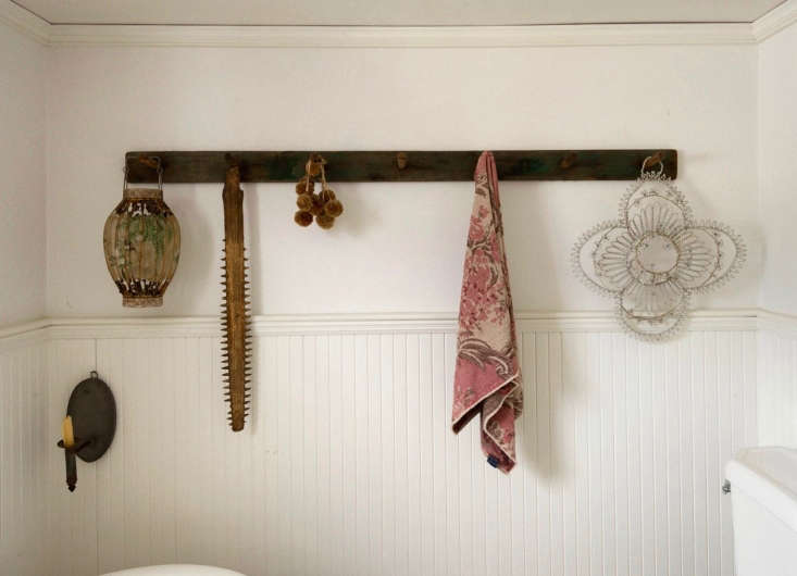 Designer John Derian adorned the walls of his Provincetown bathroom with a vintage sawfish snout, among other ephemera.