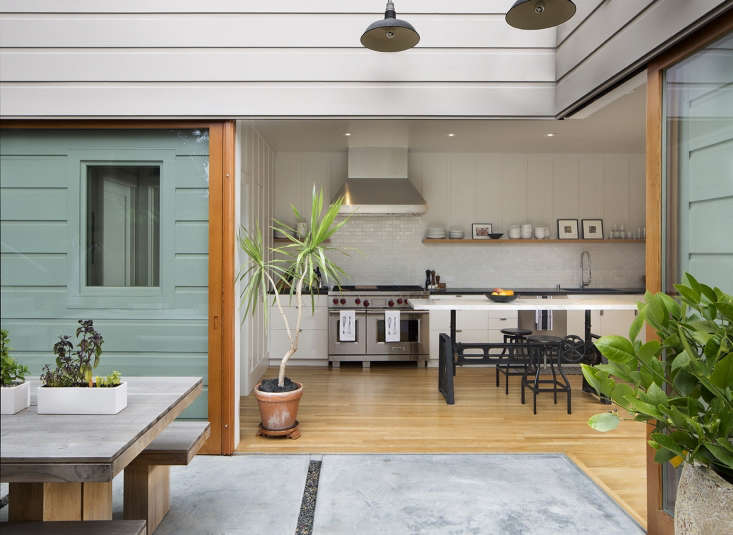 "A San Francisco couple now have ""a bit of peace in the middle of the city,"" thanks to architect Malcolm Davis, who opened up their kitchen to create room to entertain both indoors and out. Photograph by Paul Dyer courtesy of Malcolm Davis Architecture, from Kitchen of the Week: A Modern Farmhouse Kitchen in SF (Before and After)."