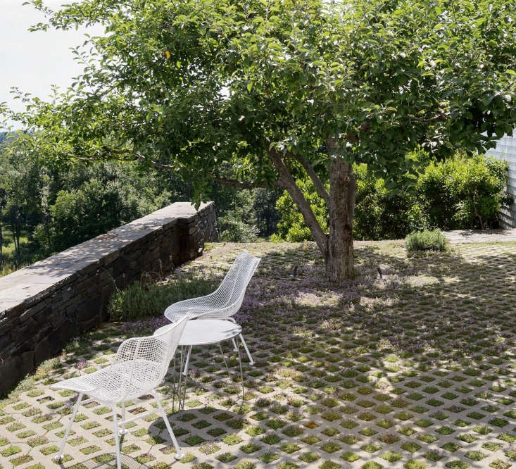 Architect Steven Harris and landscape designerLucien Rees Roberts have been collecting vintage Woodard chairs for years, giving them a home on their thyme terrace in Kinderhook, New York. Photograph by Matthew Williams.