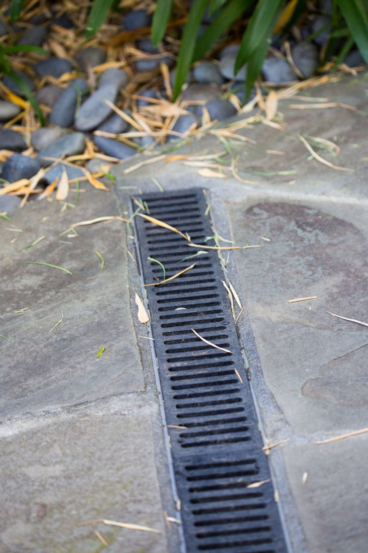 On their gently sloped property, theSterns installed a French drain system and drainage to divert water from the house.