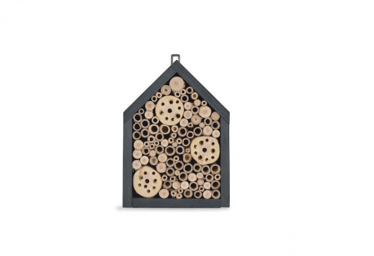 An Orkney Insect House has a pine frame stained charcoal gray and is designed to attract bees, ladybugs, and butterflies to &#8\2\20;the myriad little tubes just the right size for lots of beneficial insect species to hide their eggs in.&#8\2\2\1; It is £\2\2 from Garden Trading.