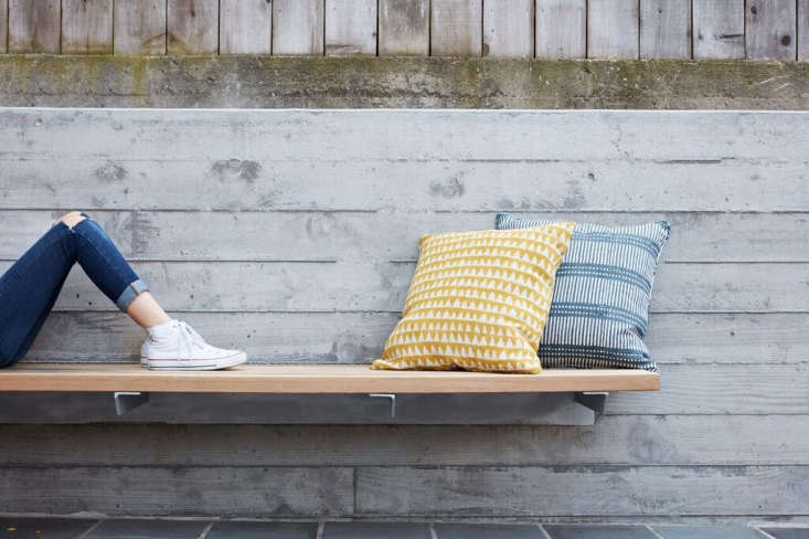 Customfloating cedar benches add built-in lounging space and &#8\2\20;create a material link between the patios.&#8\2\2\1; (Shown here: a cedar bench on the upper level.)