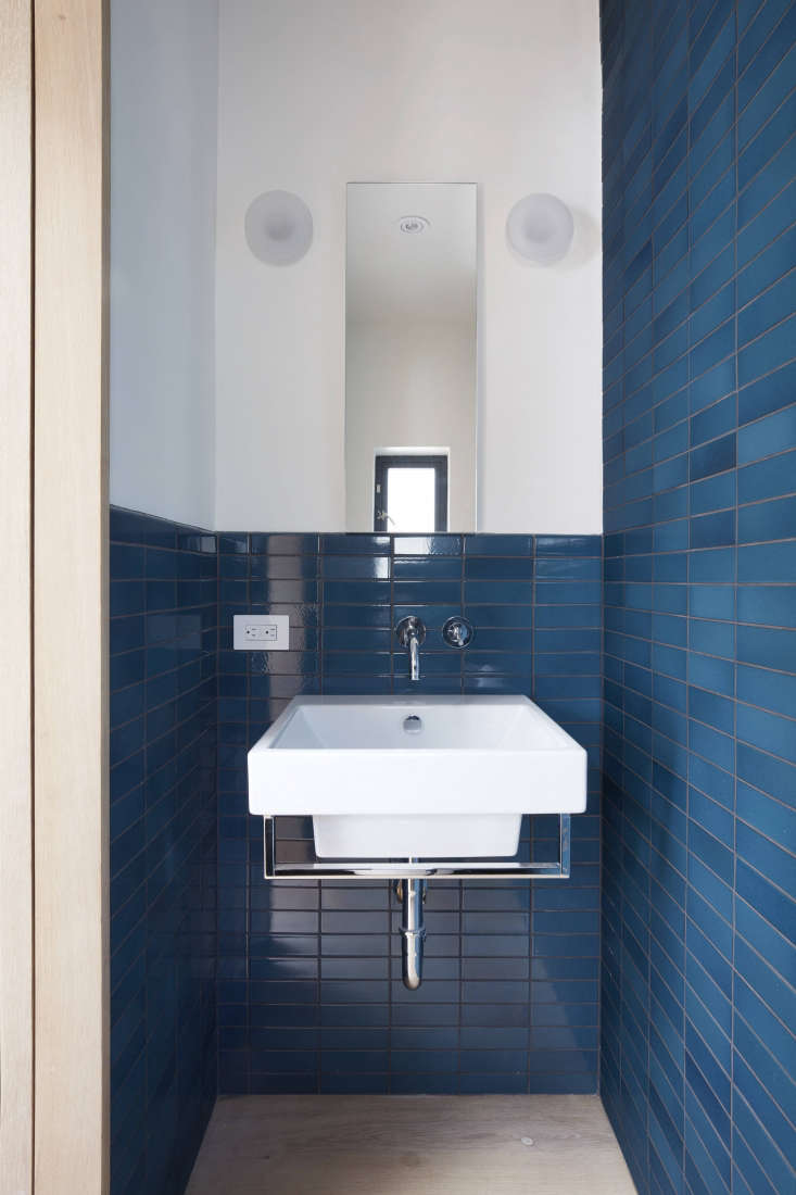 The WC is just big enough for a small sink and toilet. The blue tiles are Heath&#8\2\17;s Classic Field Tiles in Opal Pacific.