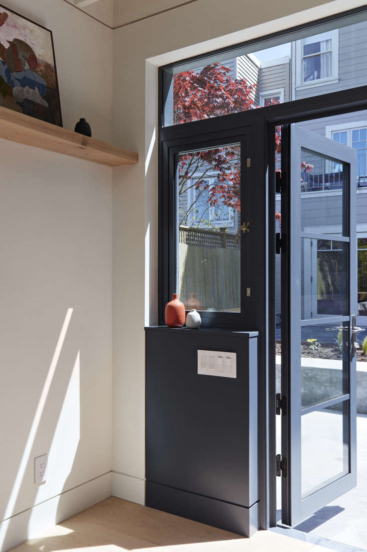 Stepping inside the studio. A newly installedwall of painted aluminum windows and doors connects the studio to the lower patio. (For a similar look in steel, seeHardscaping \10\1: Steel Factory-Style Windows and Doors.)
