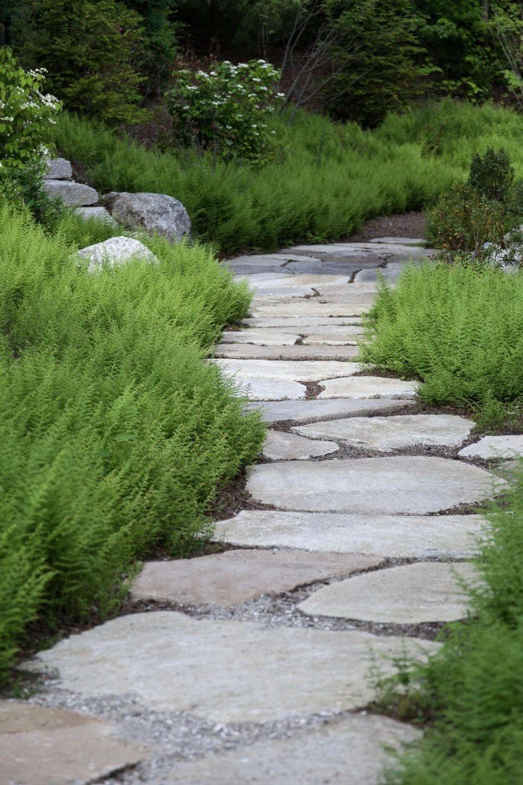 Maine coastal gardens are neither dainty nor precious. The hardscaping material of choice? Granite or fieldstone pavers that look as though they&#8