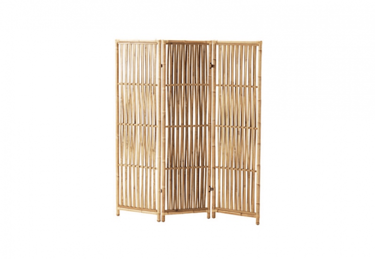 From Ikea, a three-panel rattan folding screen, the Jassa Room Divider,measures 63 by 53. inches and is $59.99.