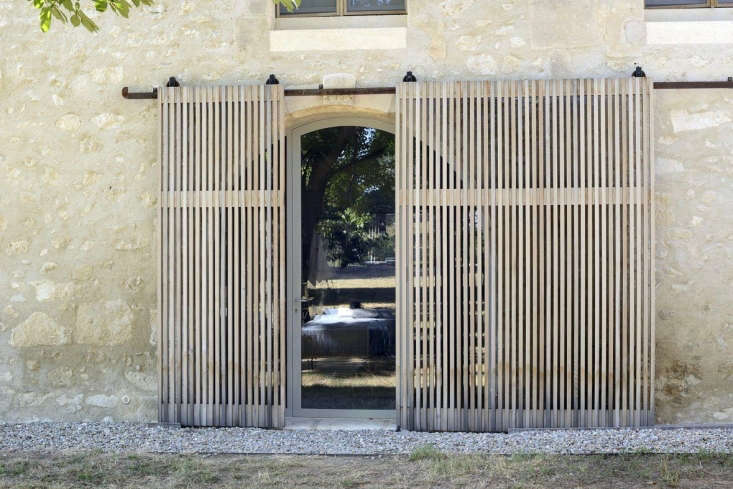 In this week&#8\2\17;s House Call post, cedar sliding screens filter in light in a restored farmhouse in Les Baux de Provence, a \15-minute drive from Arles. Photograph by Katrin Vierkant courtesy of LSL Architects.