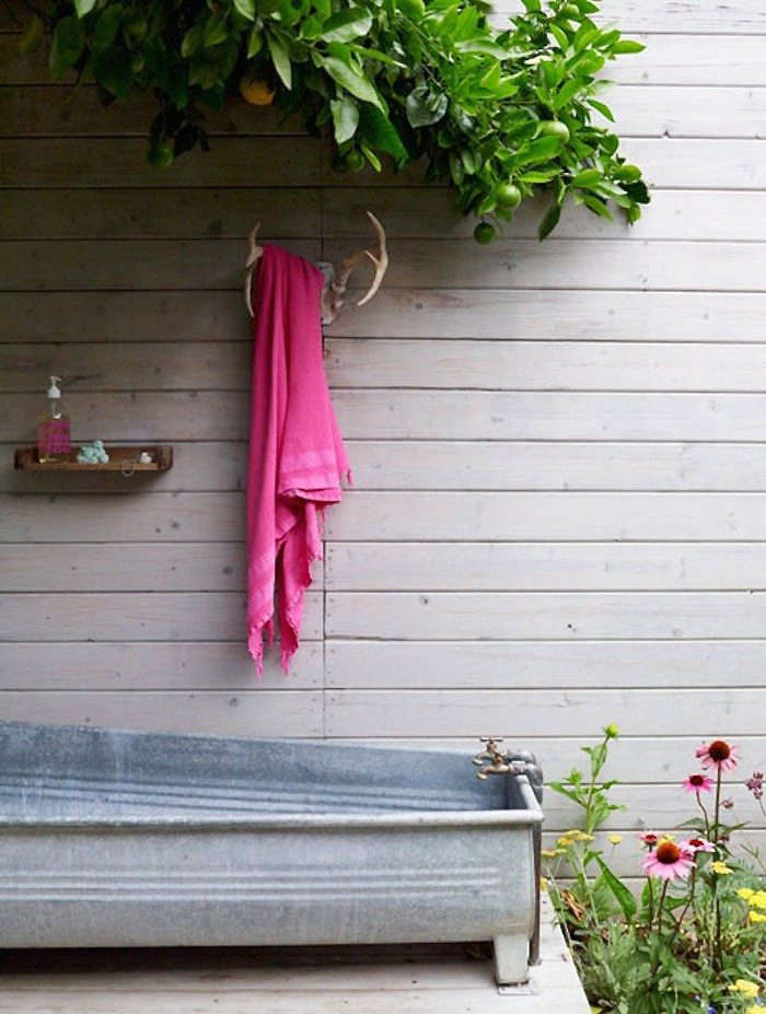 At a Los Feliz guesthouse by Los Angeles-based designer Alexandra Angle, galvanized metal trough serves as a plein-air tub. Photograph courtesy of Alexandra Angle Interior Design.