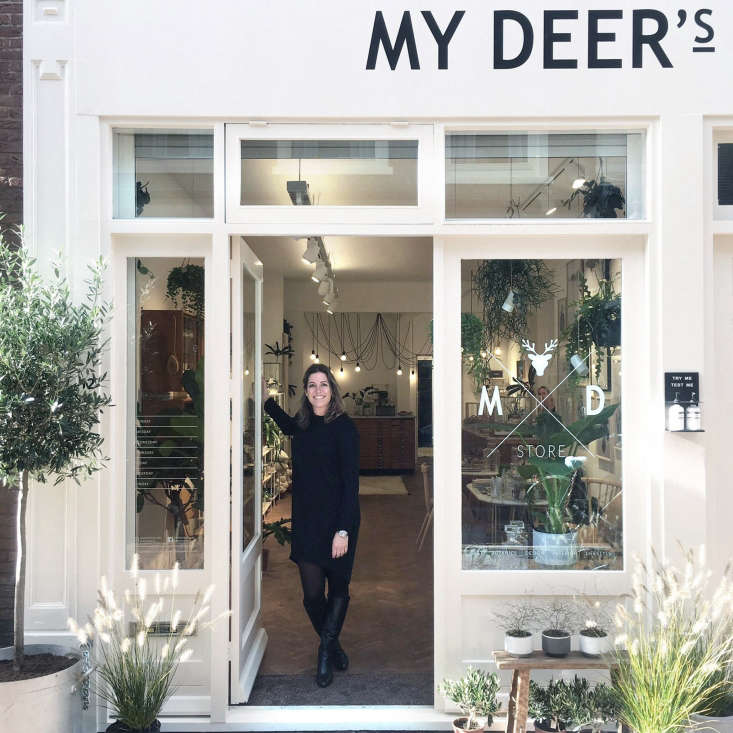 Dutch artist, interior designer, and entrepreneur Maaike Koster in her shop in the center of Haarlem. In addition to showcasing limited-edition prints of her own watercolors, Koster sells plants, furniture, ceramics, textiles, and jewelry, many from up-and-coming designers.