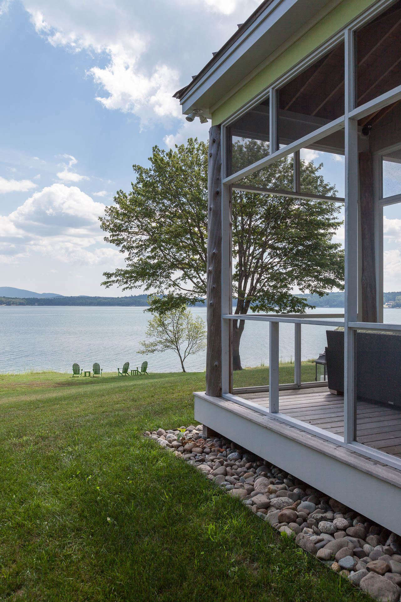 A screened porch is oriented toward the water views and has a perimeter French drain, in a garden designed by Massachusetts-based landscape architect Matthew Cunningham. Photograph by Matthew Cunningham, from Landscape Architect Visit: Clamshell Alley on the Coast of Maine.