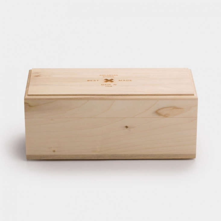 The wooden case has a rubber insert and rubber feet and measures \10by 4.75by4 inches.