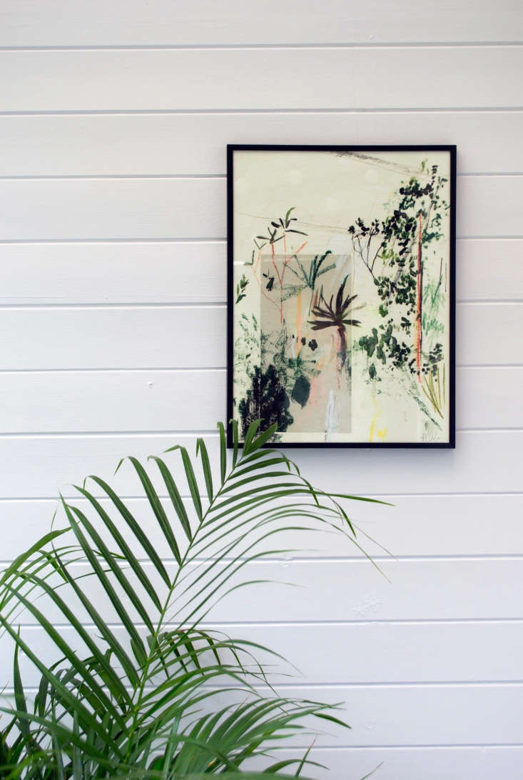 Riley placeda potted Areca palm in the back of the room to create a green backdrop.