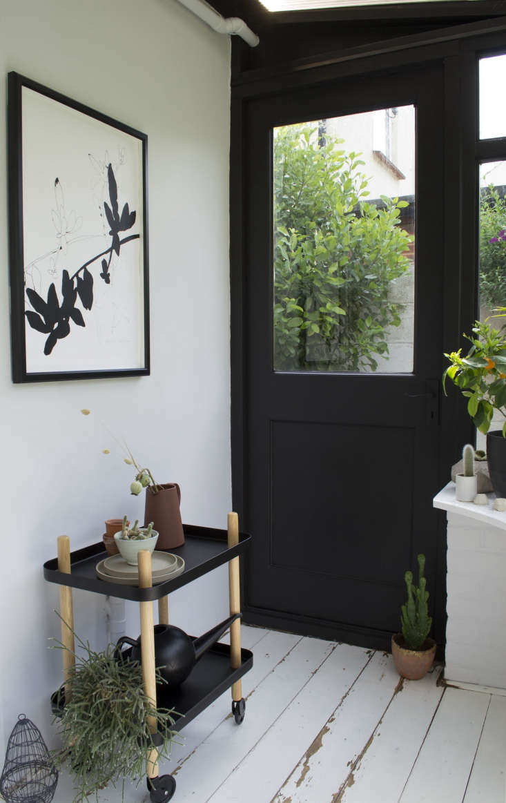 A black Normann Copenhagen Block Table is $308. The framed abstract print is by artist Alicia Galer.