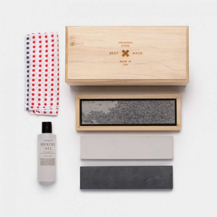 A Tri-Stone Sharpening Kit includes three stones with different grits, a tenugui cloth to wipe down surfaces, a bottle of honing oil, and a lidded hickory box with rubber feet for stability. It is \$\198 from Best Made Co.