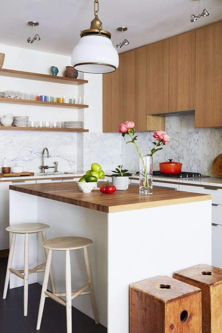 """ForourKitchen of the Week post, Alexa visitsTricia Brock, a director for HBO shows such as Girls, Breaking Bad, and Silicon Valley, in her remodeled Upper East Side kitchen, transformed from a dark space that""""had a schizophrenic feel,"""" according to her architects, Andrés Ulises Cortés and Sarrah Khan of Agencie."""