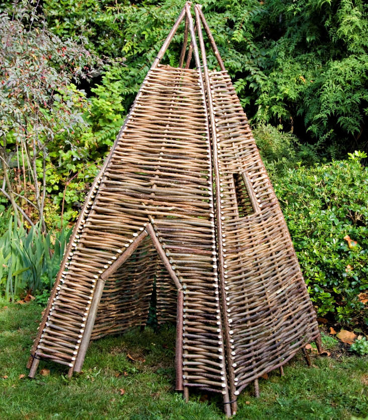 The Twigwam is one of a group of woven play structures from London garden accessories company Chairworks. This one is made in Russia of woven hazel branches. It comes in four panels that get cable-tied together (and are easy to disassemble for storage).