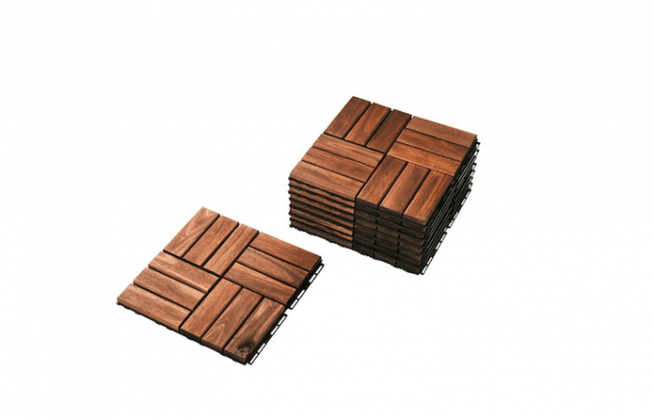 From Ikea,Runnen Floor Decking tiles are made of acacia wood. Measuring loading=