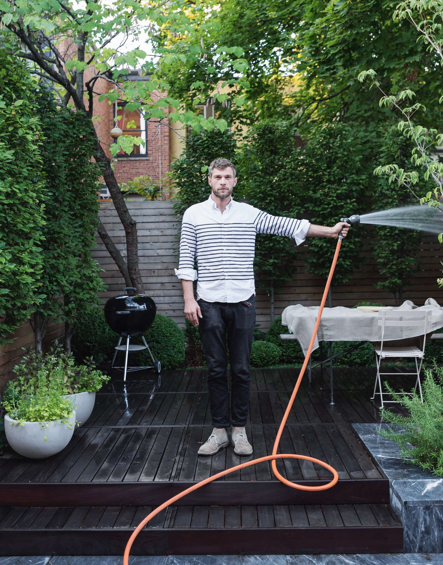 Designer Brook Klausing in a Brooklyn backyard. See more of this garden in our Gardenista book. Photograph by Matthew Williams for Gardenista.