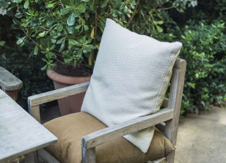 Wicker and rattan might be traditional but there's no reason not to make a conservatory comfortable with armchairs or an antique chaise for an English country house feel. When the weather is warm, the chairs can be rolled outside for lazy afternoons. Photograph by Matthew Williams for Gardenista.