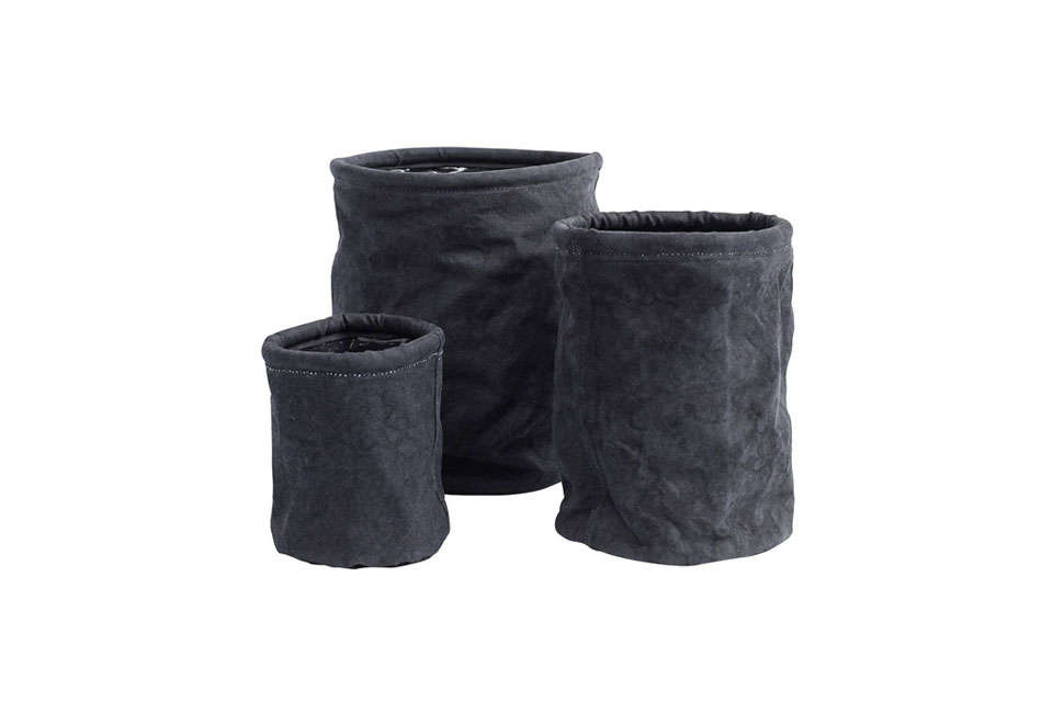 A Set of Three Black Canvas Pots by I Love Retro have a plastic lining; £35 ($45 USD) for the set at Not on the High Street.