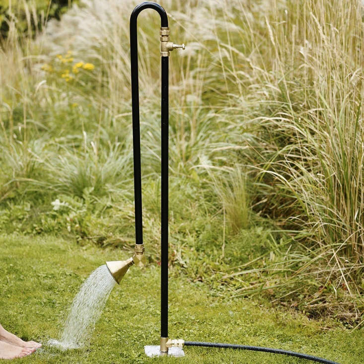 Unscrew and rearrange the lengths of powder coated galvanized pipe to convert the outdoor shower to a foot bath.