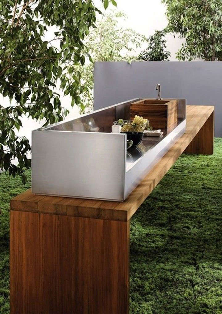 A sleek teak and steel outdoor kitchen from Italian company Mebart.
