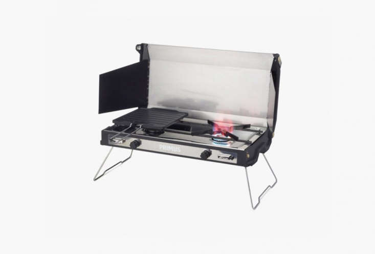 The Primus Tupike Two Burner Stove is compact, includes a wind panel, and works with standard backpacking fuel sources; \$\2\29.95 at Primus.