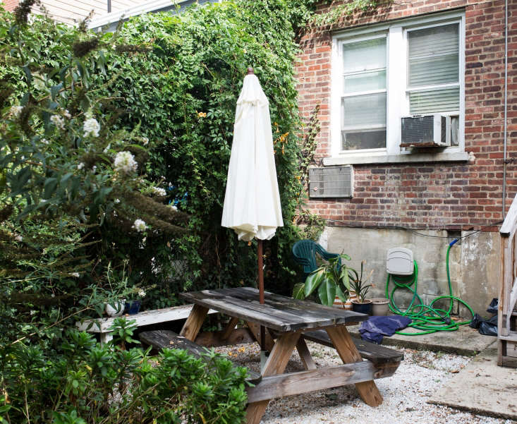 An existing patio had weeds growing up through the gravel. Photograph byLydia Hudgens.