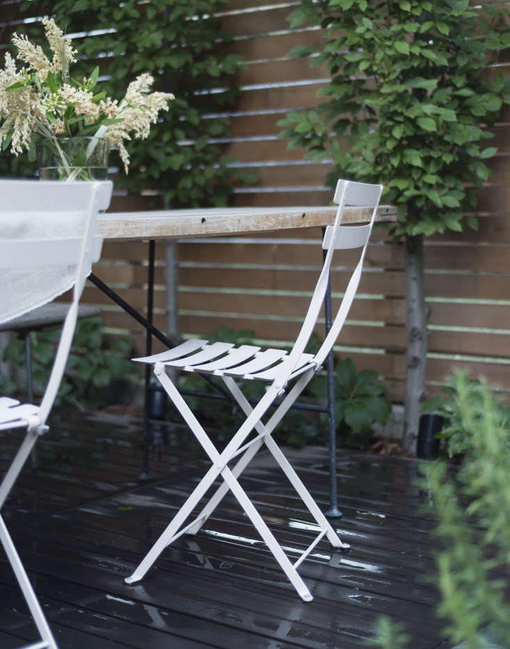 Fermob folding chairs are as useful indoors as out; in winter, take them indoor and use them as extra seating. Photograph by Matthew Williams for Gardenista.