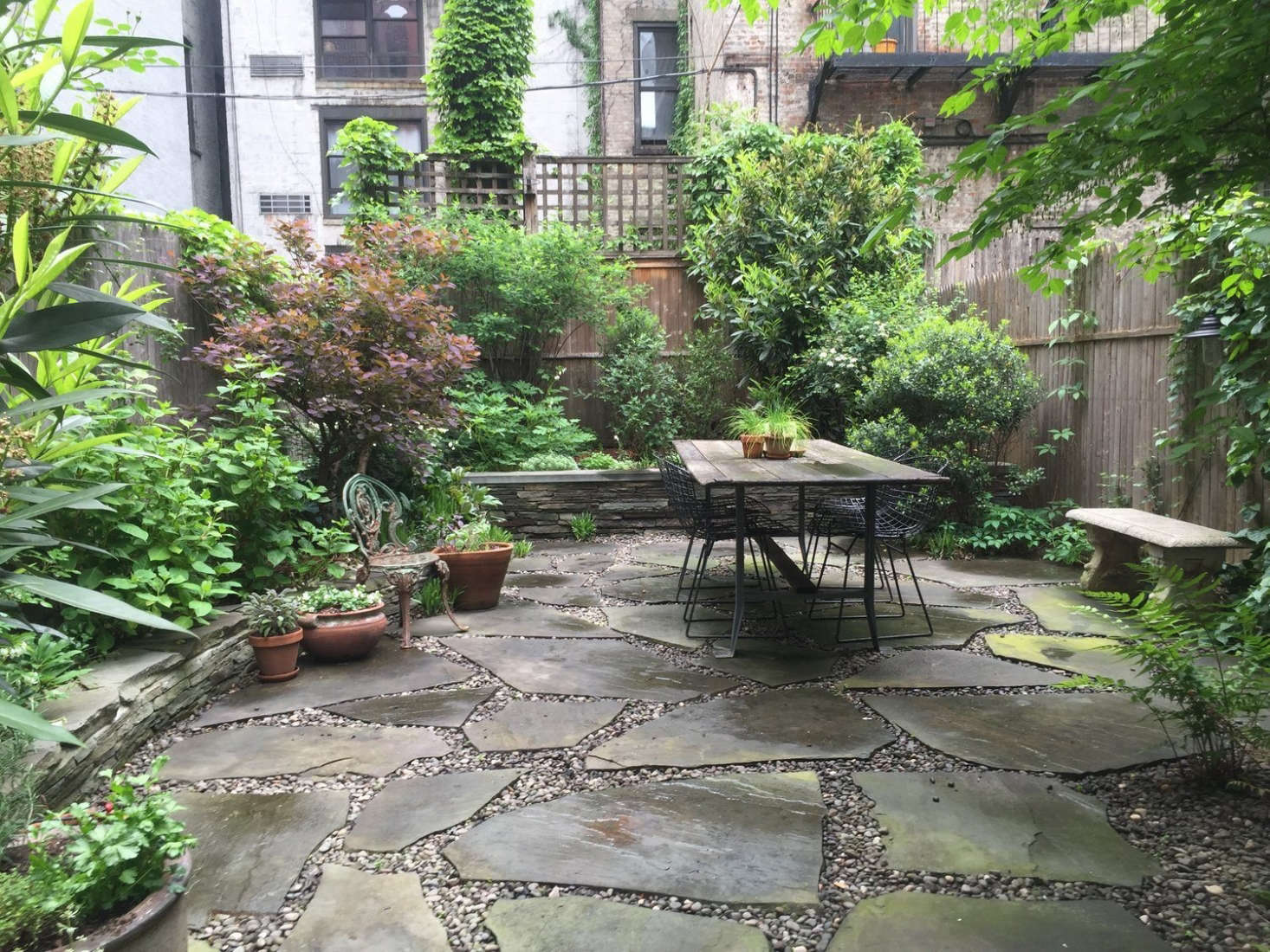 Brook created a cohesive look with a backyard patio of stone pavers &#8