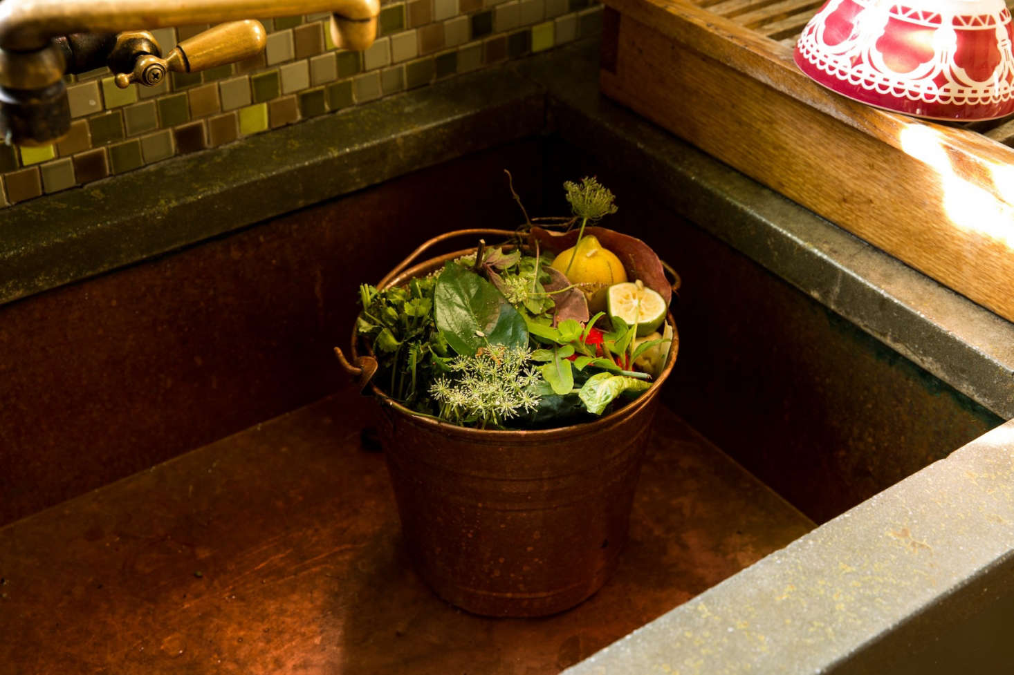 Chef Alice Waters keeps a compost bucket handy in her kitchen sink in Berkeley, California. Photograph by Daniel Dent for Gardenista.
