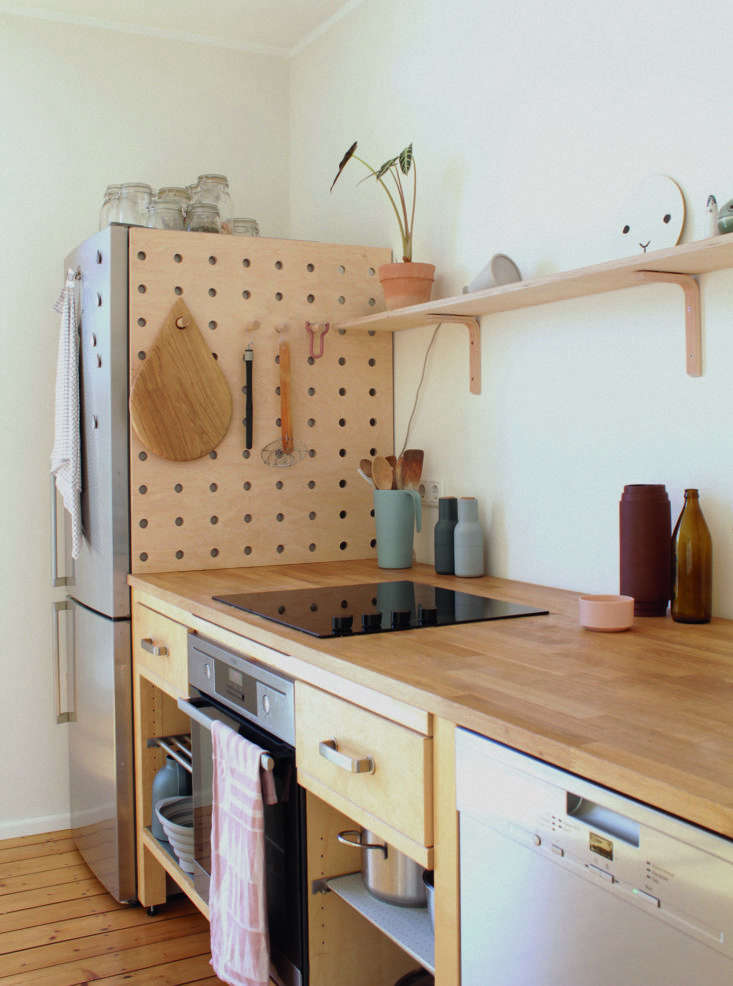 A DIY wooden pegboard in the kitchen of illustrator and graphic designer Swantje Hindrichsen; for a similar off-the-shelf storage solution, consider Kreisdesign'sPeg-it-all (£\195).
