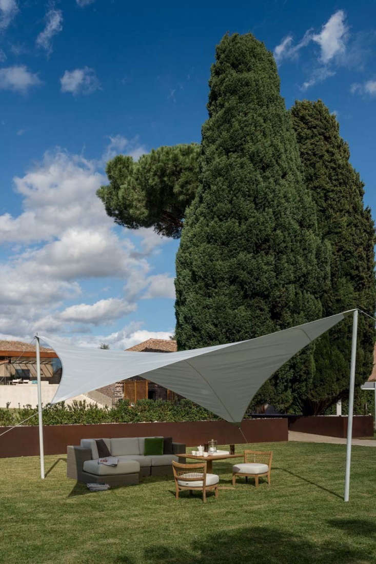 The Unopiu Rhomboidal Shade Sail includes \2 wood posts, tension pegs, and ropes and is made of 39-percent coated polyester with 6\1-percent PVC; €646 (\$767 USD) at Unopiu.