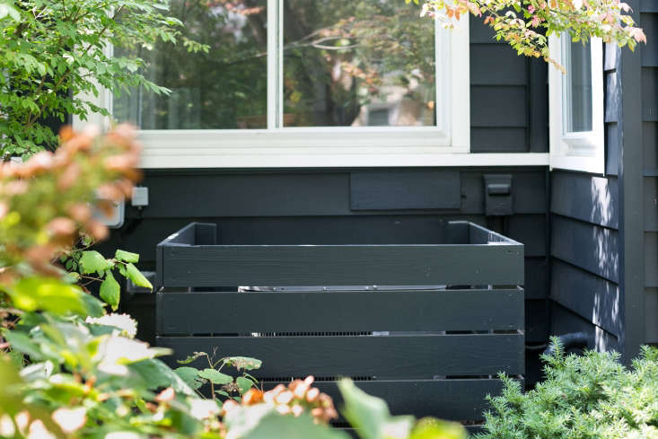 """In Ann Arbor, Michigan, &#8\2\20;I asked my dad if he could build a simple wooden cover with horizontal lines to mimic the siding on my house,"""" says Michelle Adams. """"It worked! He's pretty proud of it."""" See more of this project atBefore & After: A Garden Makeover in Michigan for Editor Michelle Adams.Photograph byMarta Xochilt Perez."""