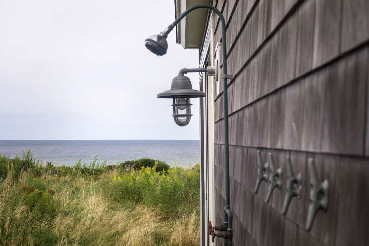 An outdoor shower-with-a-view is enhanced by simple nautical elements.