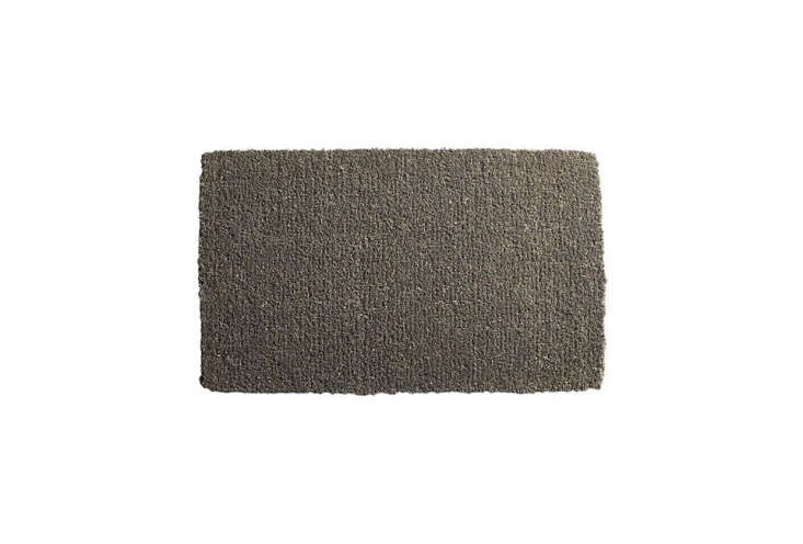 TheSlater Jute Coconut Doormat is made of dark grey-dyed coir; $.95 at CB